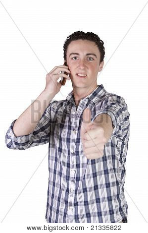 Casual Businessman Talking On The Phone While Giving The Thumbs Up