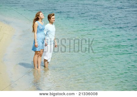 Photo of serene couple in water enjoying summer vacation