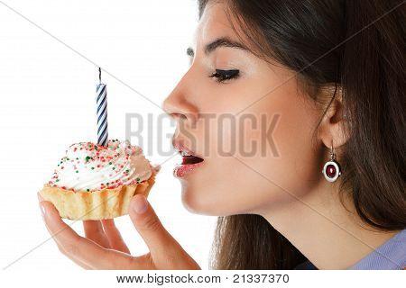 Beautiful Young Woman Eating Cupcake