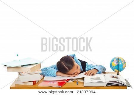 Tired Schoolgirl Sleeping On Books