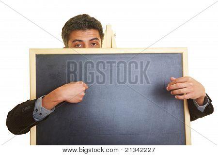 Man Behind Blackboard