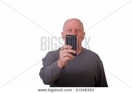 Older Balding Man Taking Picture With Smart Phone
