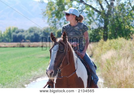 Woman Riding Paint Horse