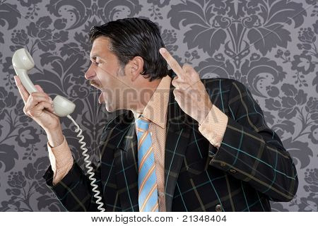businessman shouting angry expression and rude finger talking by  telephone with retro mustache