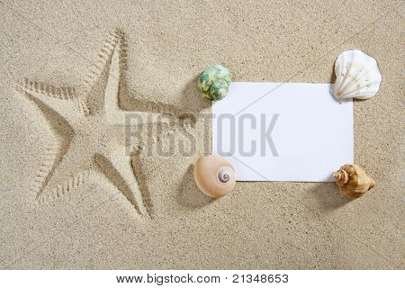 blank paper on white sand beach with shells and starfish print like a summer vacation concept