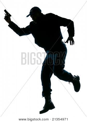 Full length of an afro American police officer running with a handgun on white isolated background