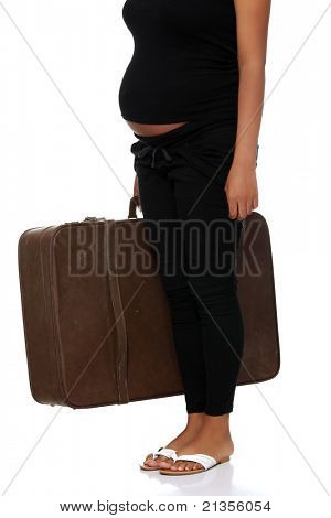 Pregnant woman with old suitcase, isolated on white