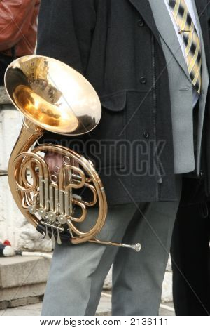 French Horn In The Hand