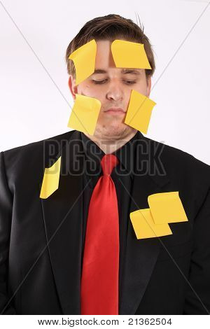 Bored Businessman With Sticky Note Paper