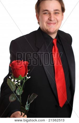 Young Man Offering You A Rose