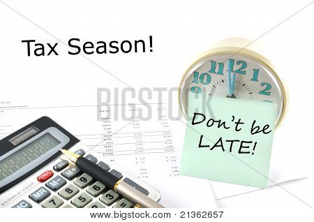 Tax Season!  Concept Image With Calculator And Clock