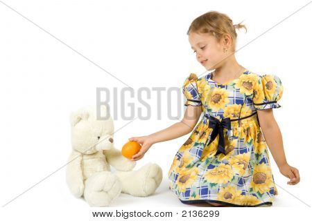 Little Girl With Orange And Bear Toy.