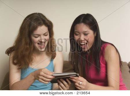 Two Friends Laughing At Photographs