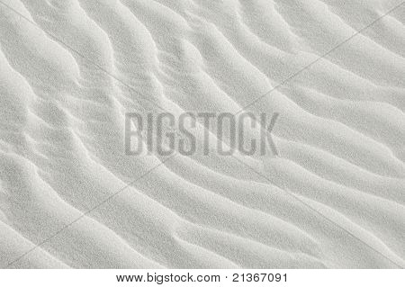 white sea sand texture on sunset