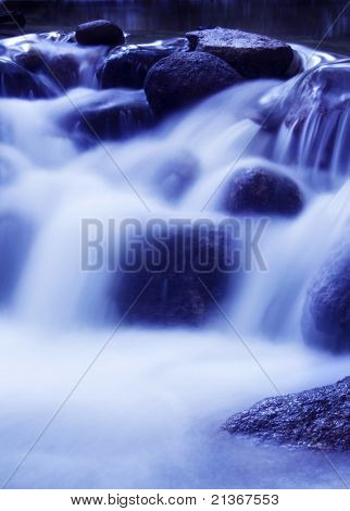 Natural waterfall in tropical rainforest Malaysia in early morning.