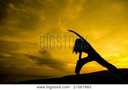 Silhouette of Woman Practicing Yoga (Warrior Pose)