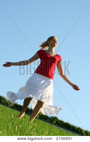 Young Woman Dancing In Field