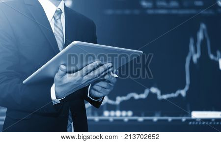 poster of Businessman using digital tablet, raising graph background. Business growth, investment and invest in stock exchange market