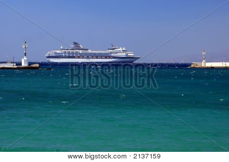 Cruise Ship Passing By The Old Port Of Mykonos, Greece