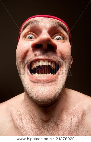 Portrait Of Insane Surprised Man