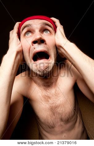 Terrified Screaming Man Holding His Head