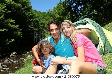 Family camping in mountain during summer vacation