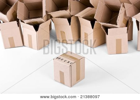 Open boxes behind one sealed box infront