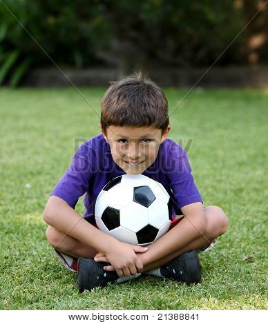 Young Latino Boy With Soccer Ball