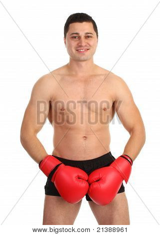 A Guy Covering His Groin With Boxing Gloves