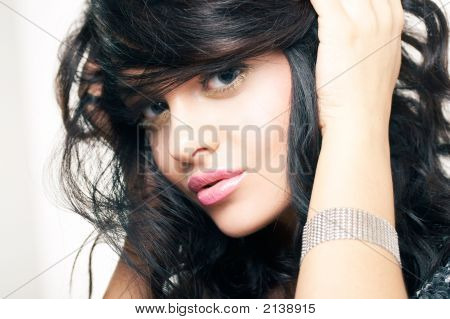 Portrait Of Beautiful Brunette With Hand Neer Face