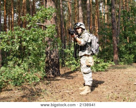 Soldier Aiming In The Woodland