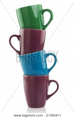 Stacked Multicolored Mugs Isolated on White