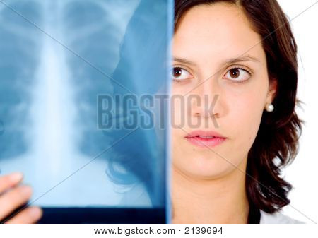 Female Doctor Checking An Xray