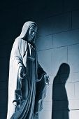 stock photo of forgiven  - A Statue of a madonna statue in blue tone.