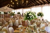 foto of crockery  - Indoors wedding reception venue with decor selective focus on flowers - JPG
