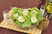 stock photo of ouzo  - Mimosa salad with lettuce and boiled eggs - JPG