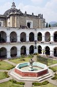 image of escuela  - Fountain in the inner yard of monastery Escuela de Cristo in Antigua Guatemala - JPG