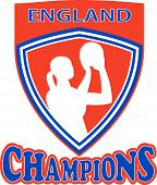 picture of netball  - illustration of a netball player shooting ball set inside shield with words England Champions - JPG