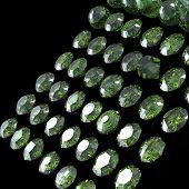 stock photo of peridot  - Round gemstone on black background - JPG