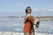 stock photo of chukotka  - Dancing chukchi woman in the folk dress - JPG