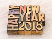 Happy New Year 2018 greeting card - text in vintage letterpress wood type blocks on a grained wooden poster