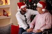 elderly father with his smiling son spending Christmas holiday together poster