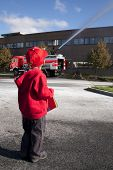 Child watching fire truck