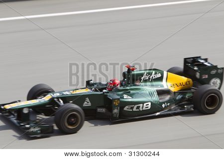 Heikki Kovalainen down the main straight