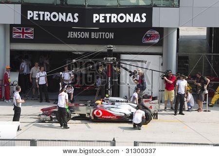 Lewis Hamilton enters his pit area