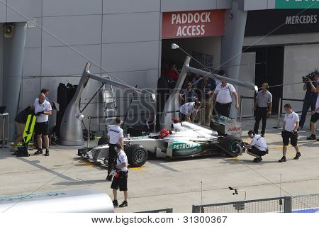 Michael Schumacher has his tyre inspected