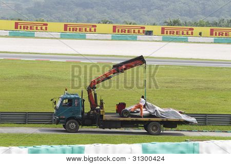 HRT F1 car towed back to pits after accident