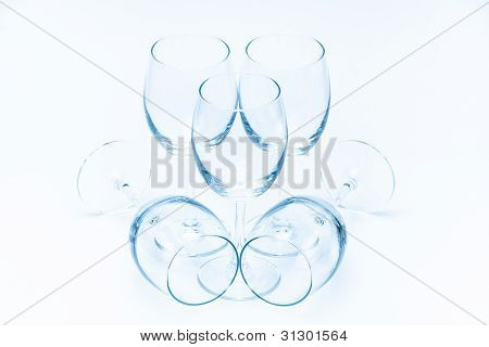 Wine glasses stand and lie symmetrically