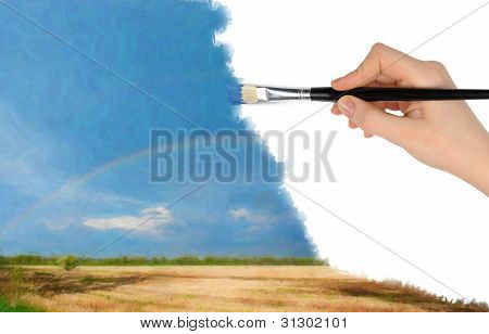 The Hand With A Brush Draws A Landscape.