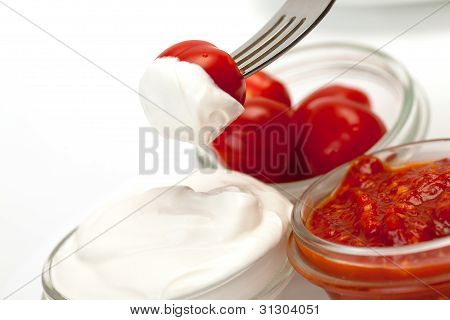 Sour Cream, Catchup And Tomato On Fork